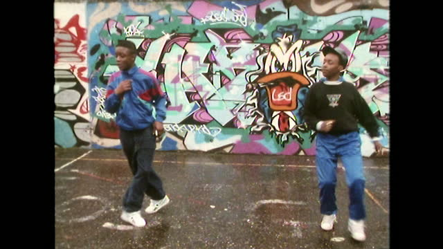 two boys dance to rap music in front of graffiti wall; 1989 - cap stock videos & royalty-free footage