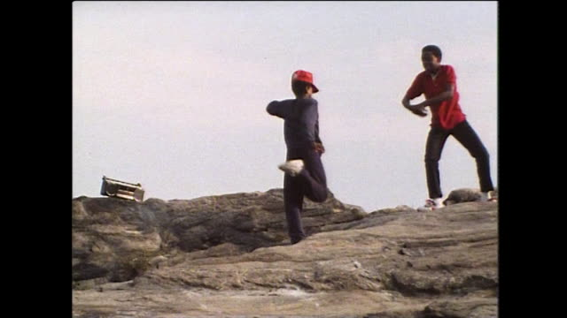 two boys dancing on a rock in new york city 1984 - jeans stock videos & royalty-free footage