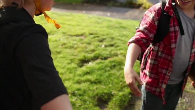 two boys doing high five - high five stock-videos und b-roll-filmmaterial
