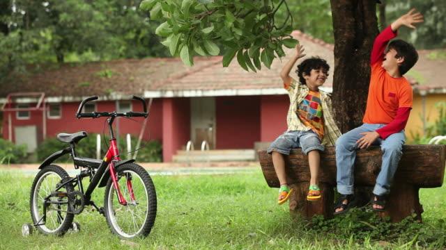 Two boys enjoying in a park