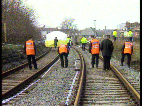 two boys found guilty of abduction and murder of james bulger itn liverpool seq police at railway track where james's body was found - merseyside stock videos and b-roll footage