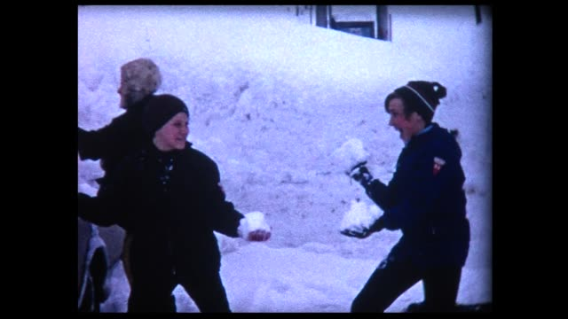 1969 two boys in snowball fight - teenage boys stock videos & royalty-free footage