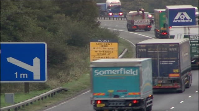 two boys killed as try to cross m56 motorway; england: cheshire: runcorn: ext traffic along on m56 motorway lorries and other vehicles along past... - boys beware点の映像素材/bロール