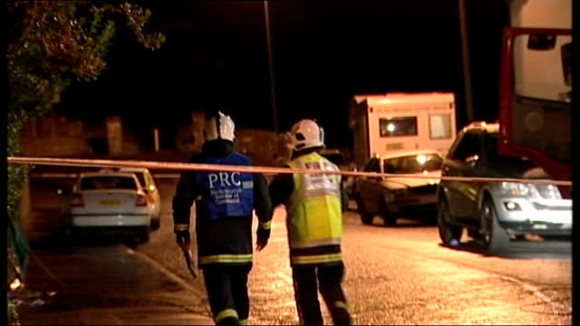two boys killed by carbon monoxide poisoning in castlerock holiday flat northern ireland county londonderry castlerock police officers outside... - carbon monoxide stock videos & royalty-free footage