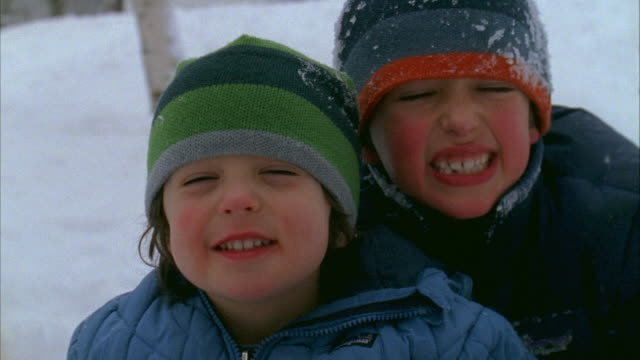 CU, Two boys (2-3, 6-7) making faces, Winter, Yarmouth, Maine, USA