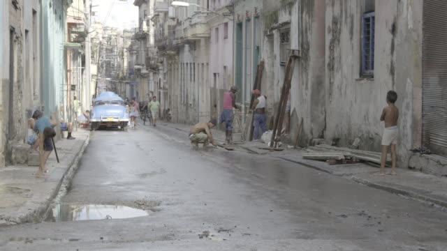 two boys play in urban street - havana stock videos & royalty-free footage