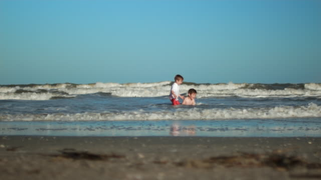 two boys playing at the beach 4k - brother stock videos & royalty-free footage
