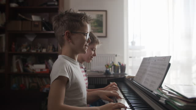 two boys playing digital piano together - imgorthand stock videos & royalty-free footage