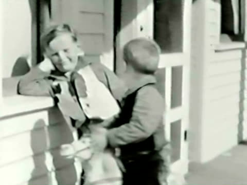 vidéos et rushes de montage two boys (4-8) playing on rocking horse on porch / bend, oregon, usa - frère
