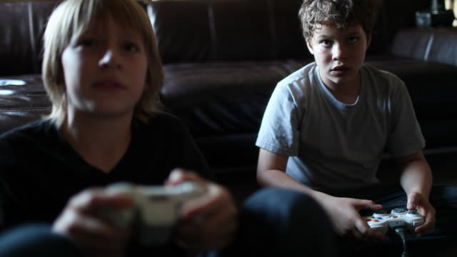 two boys playing video games - boys stock videos & royalty-free footage