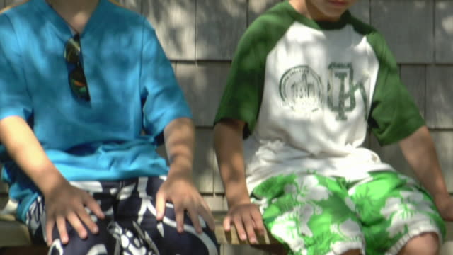 cu, tu, two boys (8-9, 10-11) sitting on porch bench, truro, caped cod, massachusetts, usa - summer stock videos & royalty-free footage