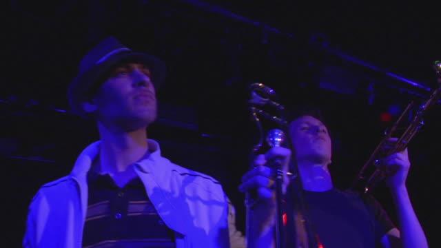la ms two brass section musicians on stage, london, england, uk - 金管楽器点の映像素材/bロール