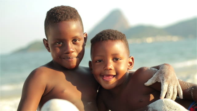 Two Brazilian boys smile for the camera with arms around each other