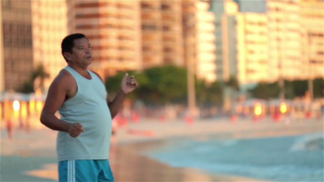 two brazilian men kick and head soccer ball back and forth on copacabana beach - juggling stock videos & royalty-free footage