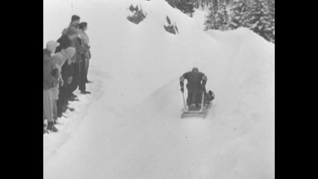 two british bobsledders prepare fourman bobsled as they practice for winter olympics / small crowd gathered at top of bobsled run / british twoman... - bobsleighing stock videos & royalty-free footage