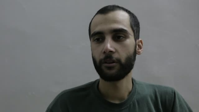 two british men who joined isis in syria say they want to face trial in the uk; syria: al-hasakah: hasakah prison: int ishak mostefaoui along and... - crime or recreational drug or prison or legal trial stock-videos und b-roll-filmmaterial