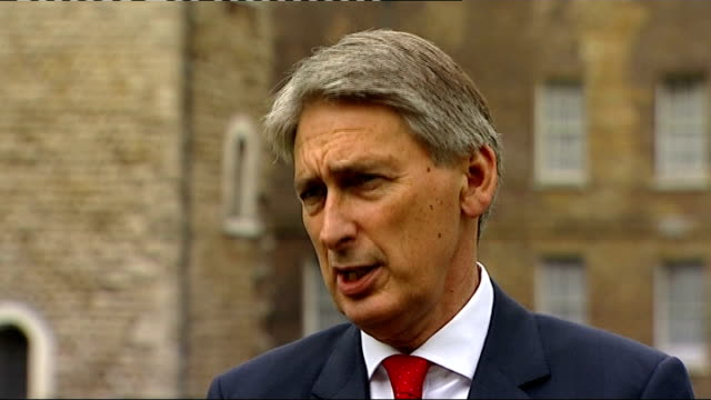 two british soldiers killed in afghan insider attack london ext philip hammond mp interview sot say same thing again today / message i'm getting from... - fadenkreuz stock-videos und b-roll-filmmaterial
