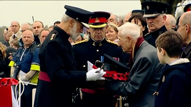 two british wwi soldiers buried in military cemetery harold shell being presented with his uncle's sword and cap by prince michael of kent harold... - prinz michael von kent stock-videos und b-roll-filmmaterial