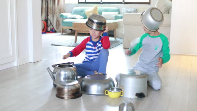 two brother playing on floor with pots and pans - child sitting cross legged stock videos & royalty-free footage