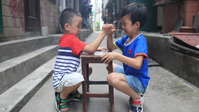 two brothers in the hutong - arm wrestling stock videos & royalty-free footage