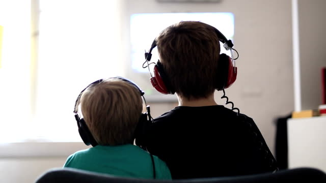 two brothers playing on games console - headset stock videos & royalty-free footage