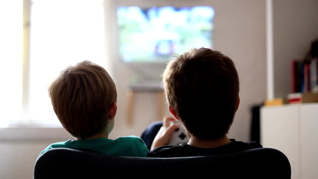 two brothers playing on games console - liquid crystal display television stock videos and b-roll footage