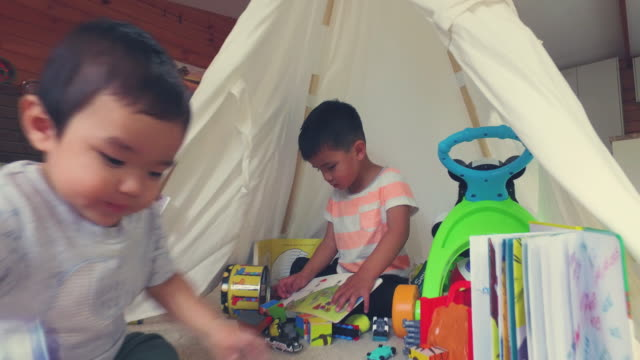 Two Brothers Playing Under Make Shift Tent.