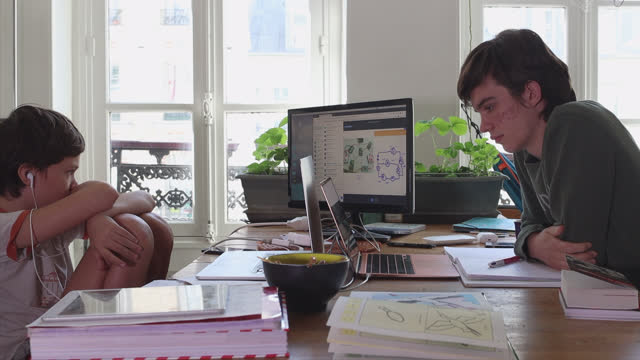 two brothers take video lessons from their home, one boy is middle school student, the other is high school student, on april 26, 2021 in paris,... - e learning stock videos & royalty-free footage