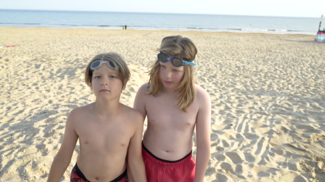 two brothers together on the beach having fun. - brother stock videos & royalty-free footage