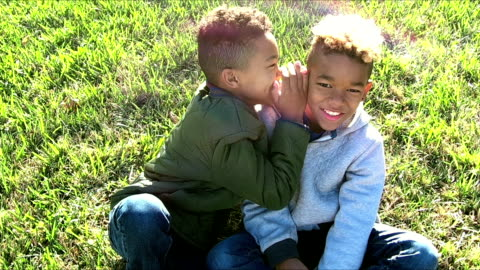two brothers whispering in each other's ears, laughing - brother stock videos & royalty-free footage