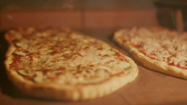 two bubbling pizzas in oven - italy stock videos & royalty-free footage
