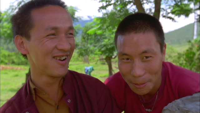 two buddhist monks smile at camera, bhutan available in hd. - bhutan stock videos & royalty-free footage