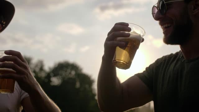 vídeos de stock e filmes b-roll de two buddies drinking beer/ katowice/ poland - evento de entretenimento