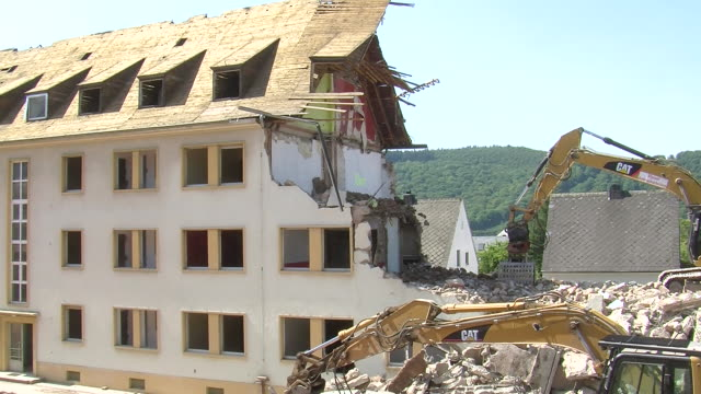 ms two bulldozers at demolition of apartment block / saarburg, rhineland-palatinate, germany - bad condition stock videos and b-roll footage