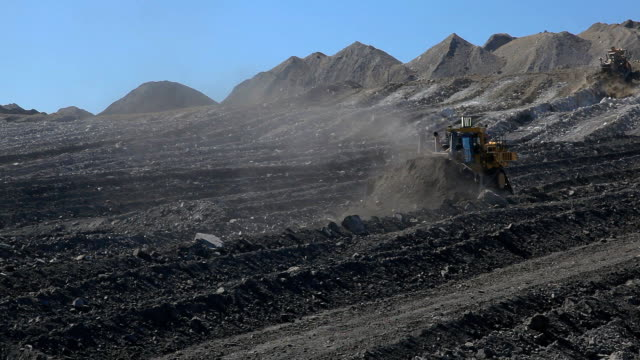 two bulldozers moving earth at a coal mine - gold mine stock videos and b-roll footage