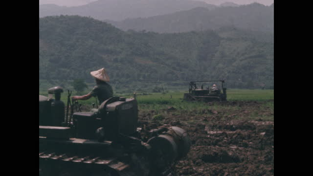two bulldozers working turning soil in agricultural fields - taipei stock videos & royalty-free footage