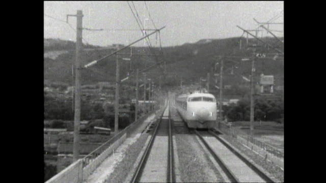 two bullet trains on the tokaido shinkansen pass each other. - showa period stock videos & royalty-free footage