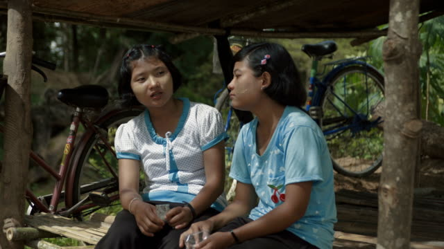 m/s two burmese teenage girls (friends) talking - myanmar stock-videos und b-roll-filmmaterial