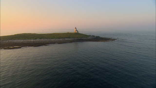 stockvideo's en b-roll-footage met low aerial, two bush island lighthouse at sunrise, maine, usa - maine