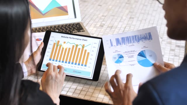 two business analysts see charts and graphs on the screen of the tablet pc - big data stock videos & royalty-free footage