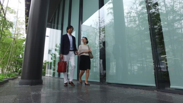 two business executives walking and talking - only japanese stock videos and b-roll footage