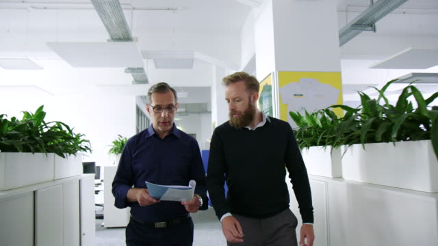 two business men hurrying up to a meeting - examining stock videos & royalty-free footage