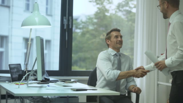 two business men meeting in manager´s office - 45 49 years stock videos & royalty-free footage