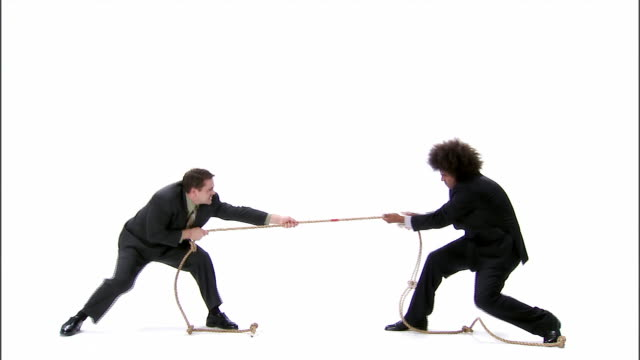 WS, two business men playing tug of war, studio shot