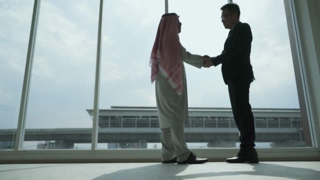 two business partners shaking hands - saudi arabia stock videos & royalty-free footage