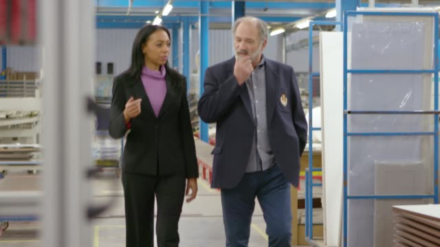 two business people in warehouse - customer stock videos & royalty-free footage