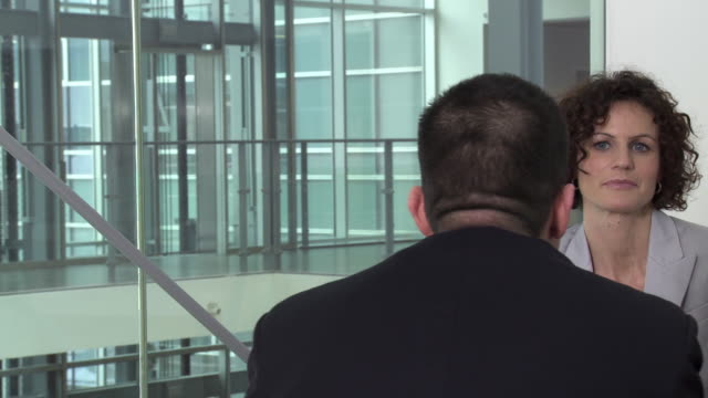 CU PAN Two business people talking at meeting in office, Copenhagen, Denmark