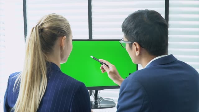 two business people talking with computer green screen - over the shoulder view stock videos & royalty-free footage