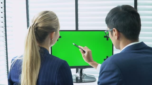 two business people talking with computer green screen - computer monitor over shoulder stock videos & royalty-free footage