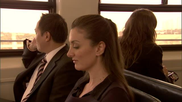 cu, zi, two business people traveling in train, sydney, australia - bahnreisender stock-videos und b-roll-filmmaterial